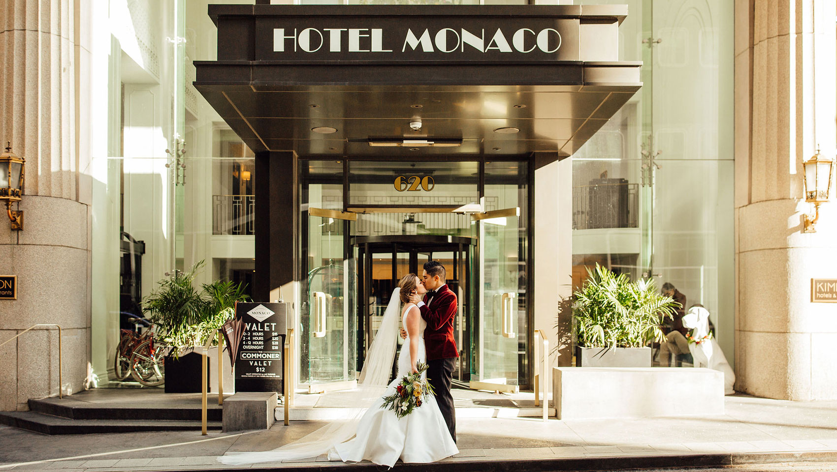 Bride and Groom in front of Monaco Sign