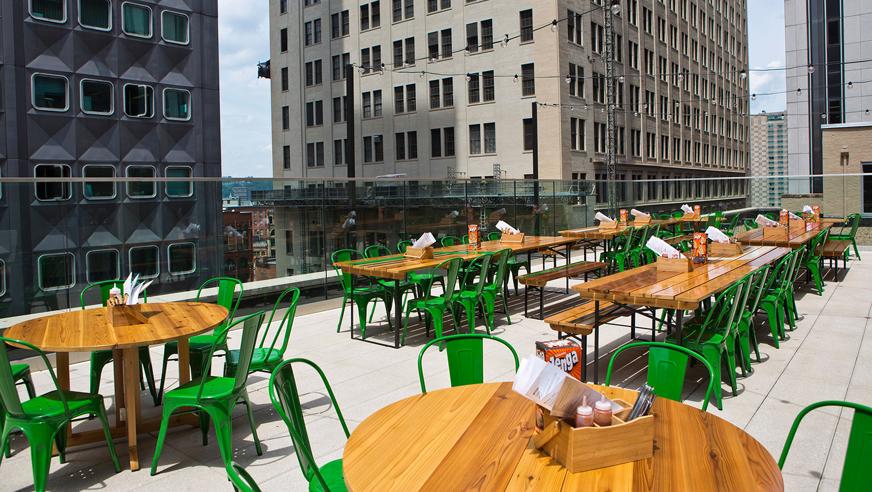 Biergarten's rooftop patio with picnic tables and chairs